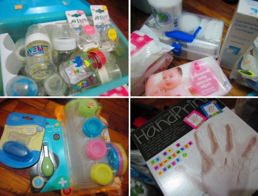 baby bottles and cotton buds and baby nail clippers and handprint mold